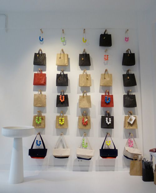 Neat grid of long pegs holds bags and necklaces