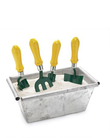 Garden tool container.  A sand-filled trough with 1/4 cup of motor oil (stir together well) will keep your tools clean, sharp and rust free!