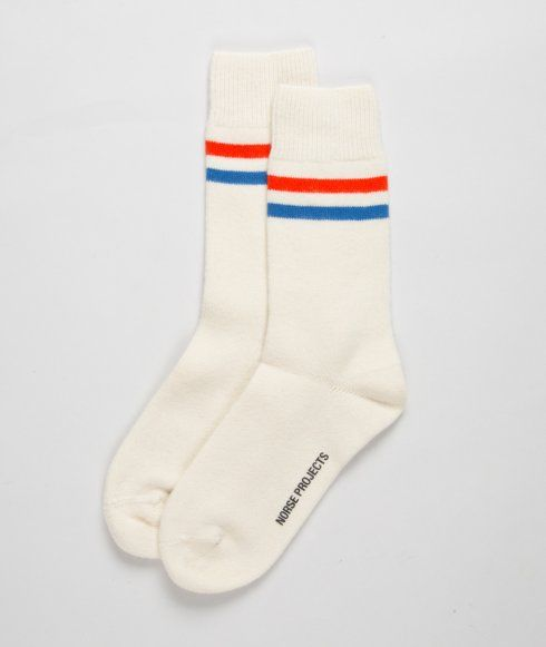 The Holiday '12 collection includes the first-ever Norse Projects socks in three colourways. The Bjarki Classic Stripe socks highlight functionality with a re-enforced heel and ribbed sections for an improved fit. Adding a sportswear-inspired touch are two striped details on the ankle.