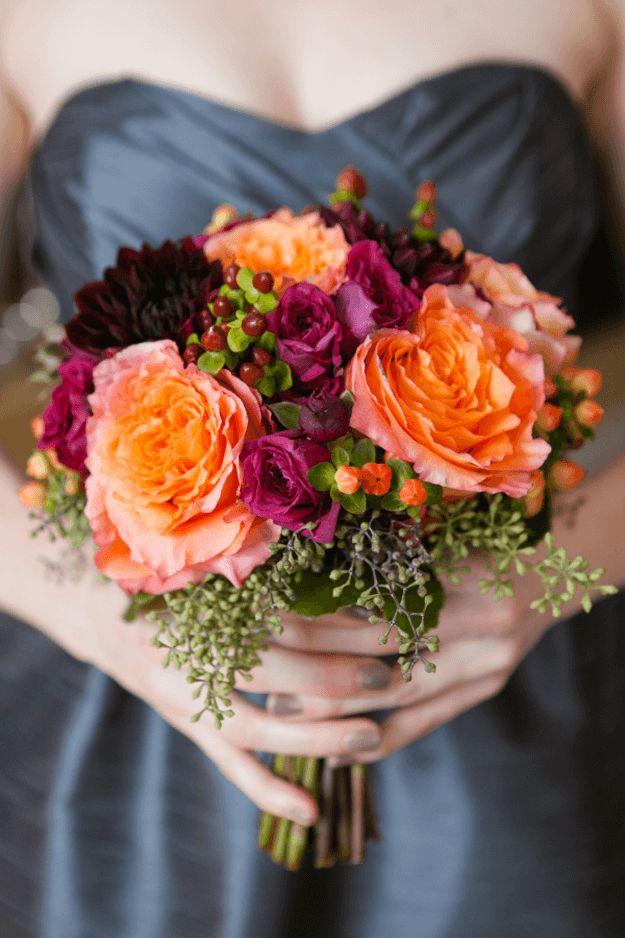 orange and plum bouquet against slate gray wedding dress, orange flowers, tangerine orange, pantone autumn maple