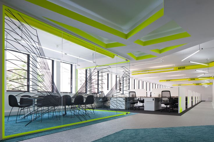Co-Work Angel was designed by PENSON to be a modern office space that's anything but boring - full of vibrant colors like neon yellow, turquoise, and red.