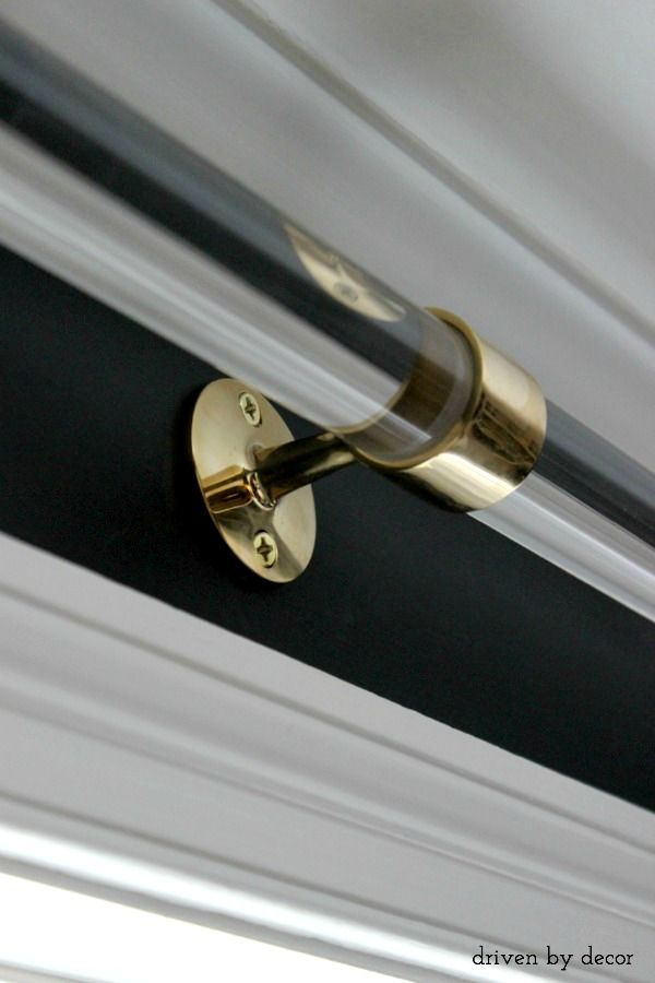 Center brass support for acrylic drapery rod