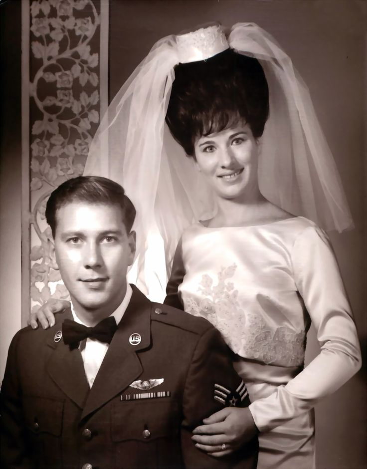 1965 bride and groom - check out her hair! And this weird thing on top of her coiffure that suppose to be the veil! Love it!