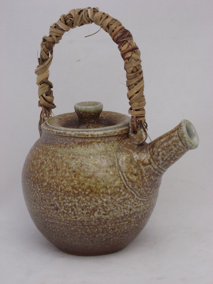 Wood fired teapot with copper wire and flax handle