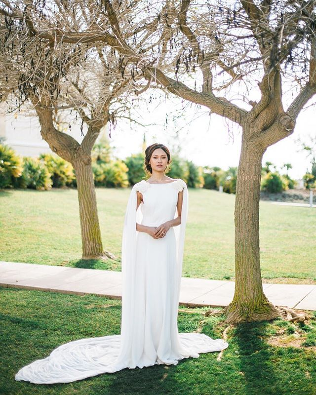 We absolutely love this beautiful wedding dress by @pureza_mb_atelier! Oh and that cape? <3 . Planning and styling by Dream Weddings Europe @anastasiiadwe Photography @atmosphere.fotografia Venue @anantaravilamoura Wedding dress @pureza_mb_atelier Flowers and decor by @ouraflores Stationery @etcandcompany Wedding cake @osbolosdorafinha MUAH @biancapereira.makeup Model @naaamta  Featured at @revistacristina / @dailycristina . . . #luxurywedding #purezamellobreyner #purezam ellobreyneratelier…