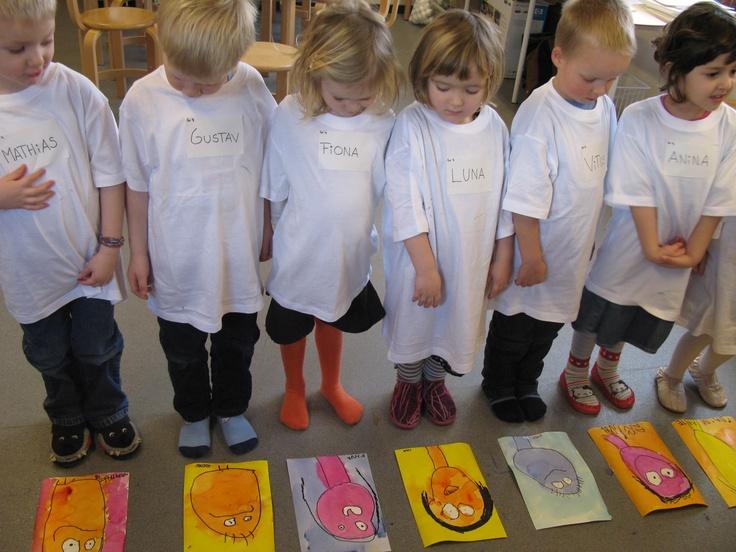 3 year old children painting portraits with artist Britta Johanson