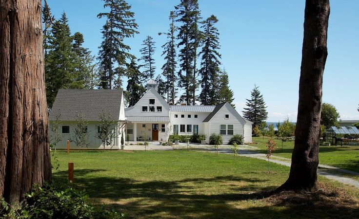 Decorative Modern Farmhouse home designing tips Transitional Exterior Seattle home insurance cast stone plant pots concrete covered entry covered porch cupola gable roof gravel greenhouse landscaping lap siding lawn mature trees metal roof shingle roof square windows water view white exterior - Decorcology.com