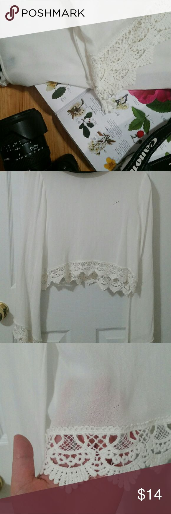 Forever 21: Bell Sleeve Lace Trim Crop Top Cropped, white, bell sleeve, flowy top. Semi sheer, no tag but never worn. Great to put over a swim top/bralette or to pair with a wide brim hat and some light blue shorts! They could also be worn during festivals as well. Forever 21 Tops