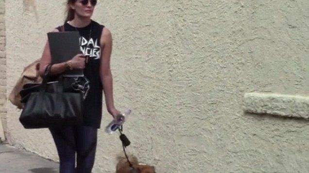 DWTS contestant Mischa Barton takes her dog for a walk before going in for a Dancing with the Stars Rehearsal.
