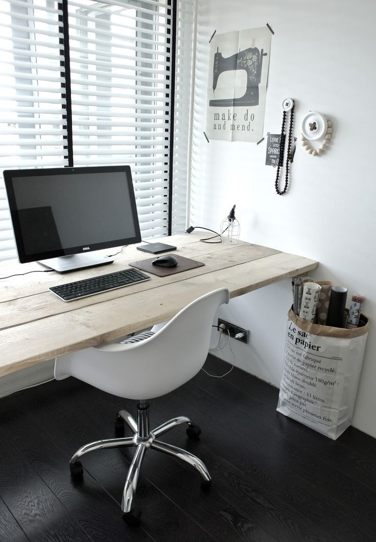 Floating desktop supported by wall bracket blocking. Clean, minimal, simple desktop workspace.  Imagine with a beautiful flower bouquet and nice lamp!