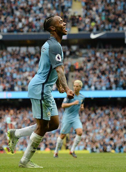 Manchester City's English midfielder Raheem Sterling celebrates after scoring…