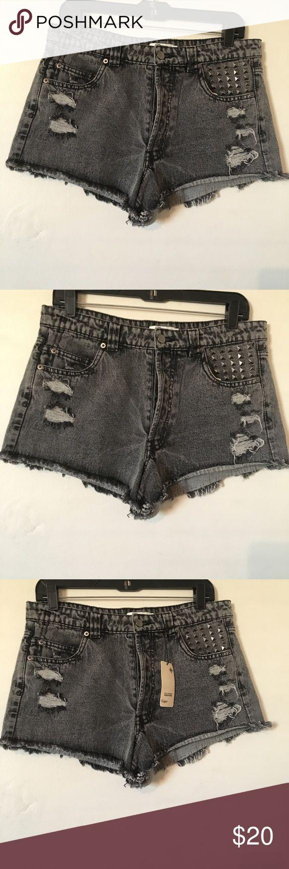 Distressed black acid washed shorts size large NWT black acid washed short. Has distressing studs and fraying size large Shorts