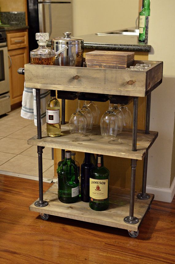 This three-tier industrial style bar cart made from solid wood and steel pipe will accommodate your barware or kitchen storage needs. This cart can be
