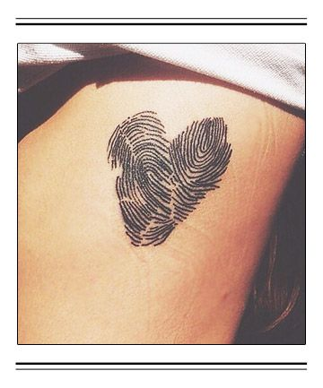 Honor your child in an artistic way by getting a tattoo of their fingerprint. We love this heart-shaped design.