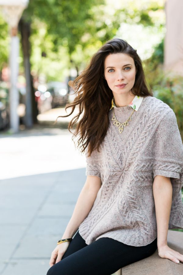 "Cusp geometric cabled poncho by Olga Buraya-Kefelian. Shown in color ""Postcard"". From Brooklyn Tweed's ""Capsule"" Collection. Photographed by Jared Flood. #capsulecollection #brooklyntweed #madeinUSA #quarryyarn #shelteryarn #loftyarn #cusp #poncho"