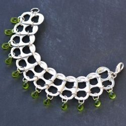 Scavenge the pop tabs off your soda cans to make this recycled jewelry piece!