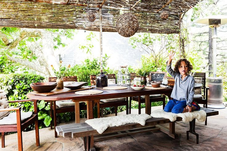 Tour the Home of Designer Claire Stansfield. She used rolls of inexpensive twig fencing (available at good garden-supply stores) to create the feeling of a thatched roof.