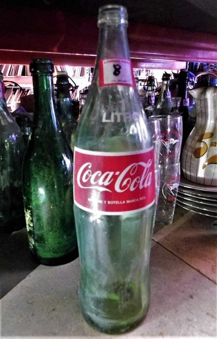 Botella Antigua De Coca Cola De 1 Litro  -----  Botella antigua de refresco, de 1 litro, de la marca Coca Cola.  -----  Ref:R0387  -----  Realizamos envíos  -----  Comparte en tu red social  -----  P.V.P 8€
