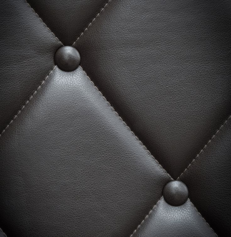 Close-up of customised seating at the rooftop restaurant of Hotel Bella Sky. Leather: SAVANNE / Colour: Dark Brown. Photo: Christian Møller Andersen from Norm Architects