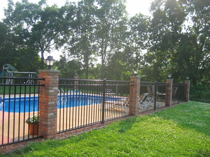 brick and wrought iron pool fencing