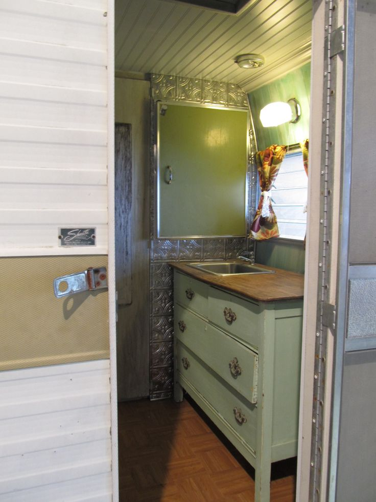the inside of a trailer that they made the sink out of an old dresser, cute!