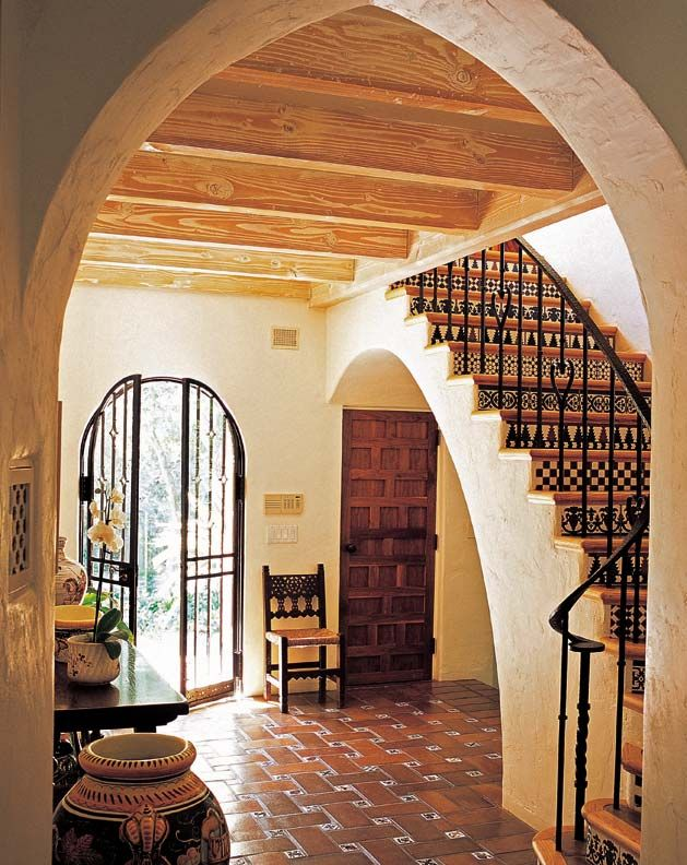 montecito spanish colonial exposed beams heavy wooden doors iron gates and tile - Spanish Home Interior Design