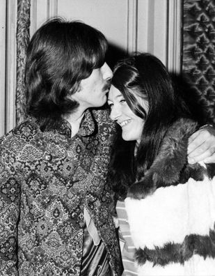 George Harrison and Freda Kelly. Wow, I just Googled her. She was in charge of the Beatles fan club and Brian Epstein's secretary. Pretty cool story behind this lady!! {GM}