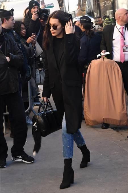 Bella Hadid wearing Givenchy Black Lucrezia Duffel, Fendi Lei 0190 Metal Sunglasses, Sandro Data Locodice High-Waist Jeans, Givenchy Coat in Black Cashmere and Wool-Blend and Public Desire Cayden Sock Point Heeled Ankle Boots