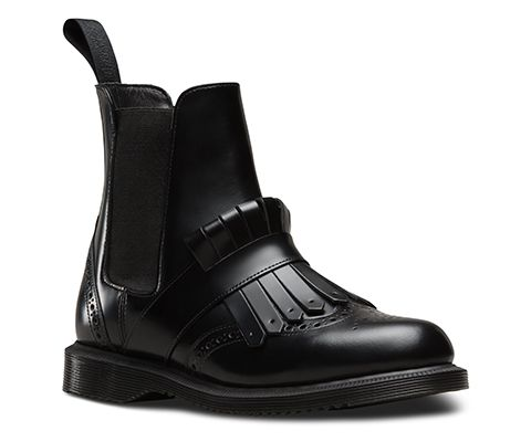 Fashion-forward and contemporary, the Tina Chelsea boot in Polished Smooth leather boasts brogue detailing, a kiltie strap and tassel, tonal heel loop and with inside gusset and side zip for ease of entry and a premium feel. Over-the-vamp strapping adds edgy detail, whilst a sleeker Goodyear welted outsole offers comfort and support. The bouncy AirWair sole is oil-and-fat-resistant, hard wearing and offers good abrasion and slip resistance.