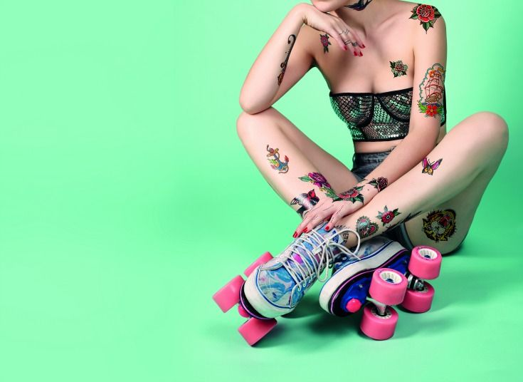 A pair of vibrantly coloured roller skates with bright pink wheels by Mauviette Tattoo