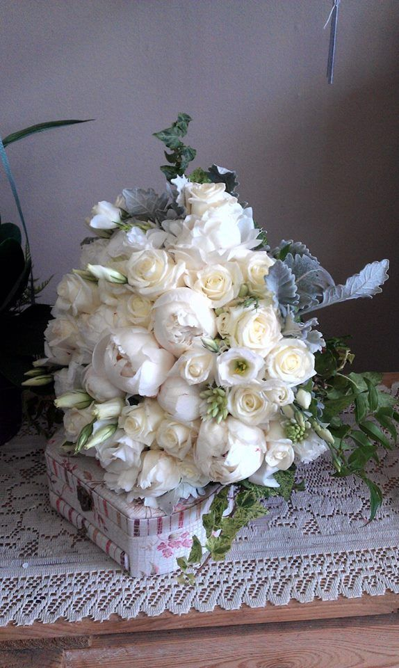 white peonies white roses white lisianthus dusty miller ivy