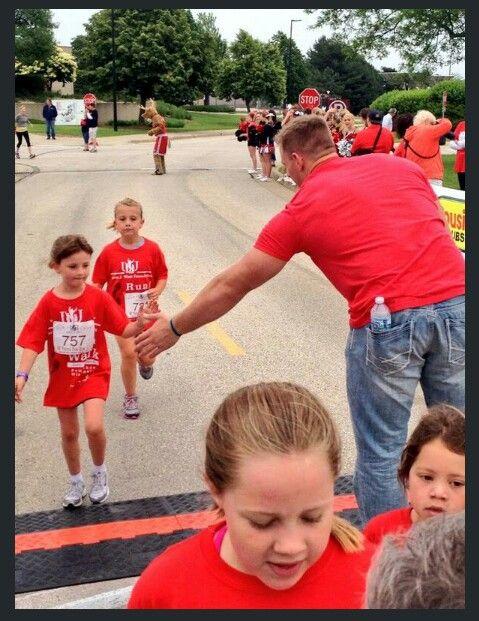 JJ Watt greeting younguns at the finish line of the JJ Watt Foundation Walk/Run