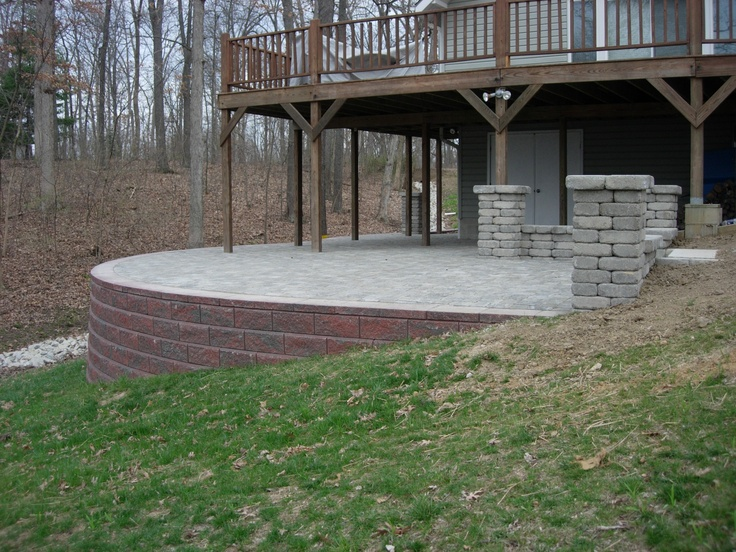 Raised paver patio retaining wall columns stone sitting for Patio and retaining wall ideas