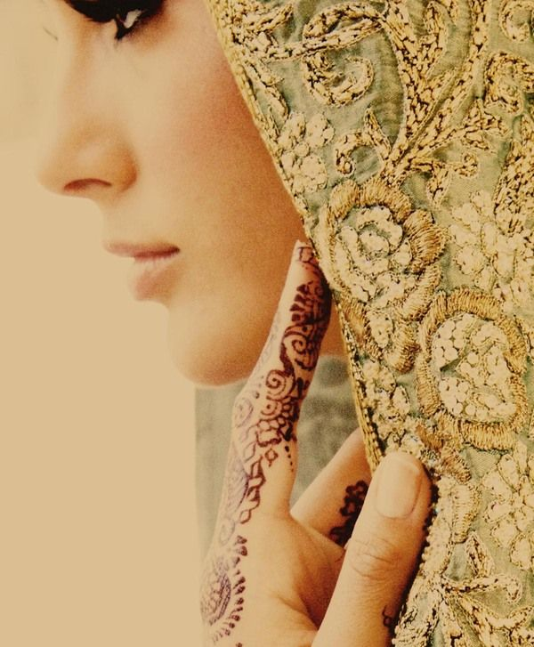 Love this beautiful portrait and the juxtaposition of the henna tattoo with the fabric texture.