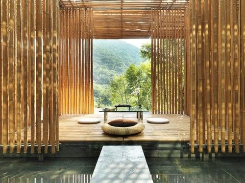 This bamboo palace near the Great Wall has bamboo walls that let light through, a platformed space and simple furniture.