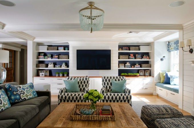15 Creative Ways to Design or Decorate Around A Flat Screen TV - Painted the back of the built-ins black to help tie the TV in