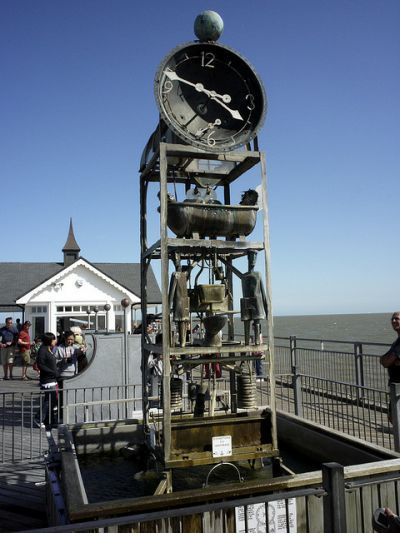 water-clock-suffolk - reated over three weeks by Tim Hunkin and Will Jackson, this clock, which sits on Southwold Pier in Suffolk, UK, was originally designed as a feature about water recycling. The clock hands and pendulum are now powered electronically, however the water which runs through the rest of the design powers the movements of a series of metal figures which sit beneath the clock-face. The quirky design makes for an interesting attraction for visitors to the pier.