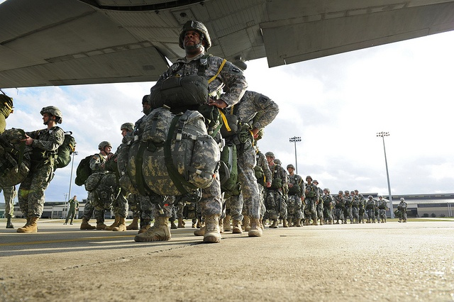 U.S. Army Soldiers board a C-130 Hercules aircraft assigned to the 61st Airlift Squadron for a personnel drop at Fort Bragg, N.C., on Feb. 29, 2012.
