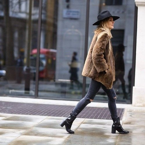 sienna miller in ripped skinny jeans, ankle boots, fur & hat