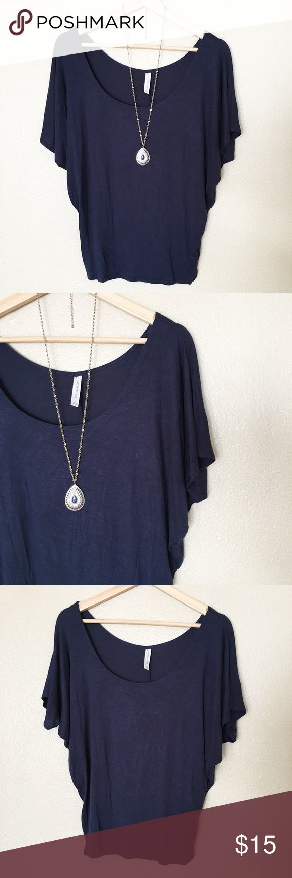 "Navy Blue Batwing Top Casual navy blue batwing top. In good condition. Size L (more like a junior's Large). Measurement from top of shoulder to bottom is 24"". Stretchy material. 95% Rayon, 5% Spandex.  **Listed as Forever 21 for visibility only.** Thanks for looking! Forever 21 Tops"