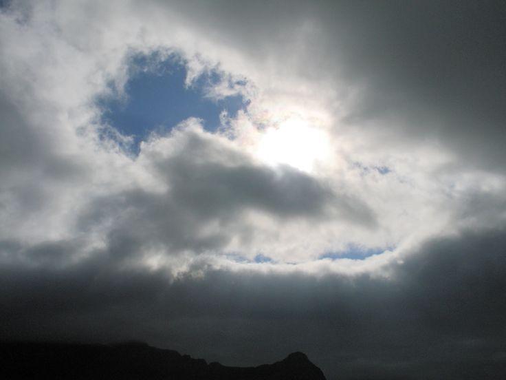 The sun trying to peep through the clouds at Viðareiði.