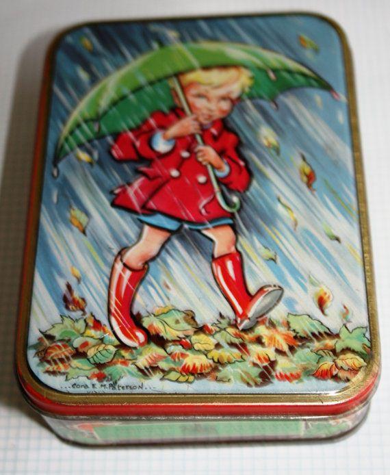 Delightful Edward Sharp toffee tin with boy umbrella by Tinternet