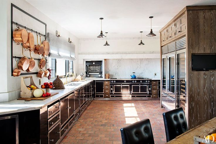 Pompeo's dream kitchen includes a La Cornue range, oven, and cabinetry and a Carrara-marble backsplash; the pendant lights are from Treillage, the custom-made pot rack is by Bullard, and the sink and fittings are by Waterworks.