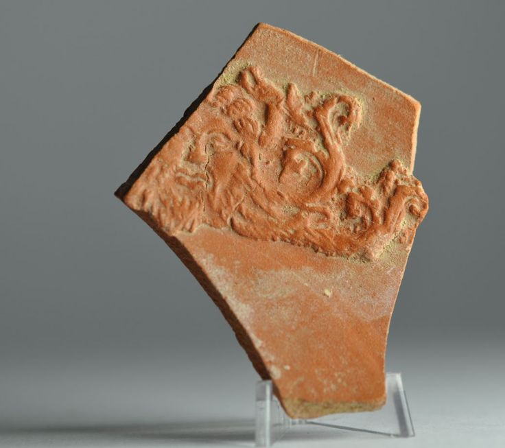 Poseidon the ocean god on african red slip ware sherd with Poseidon head, 4th century A.D. Private collection