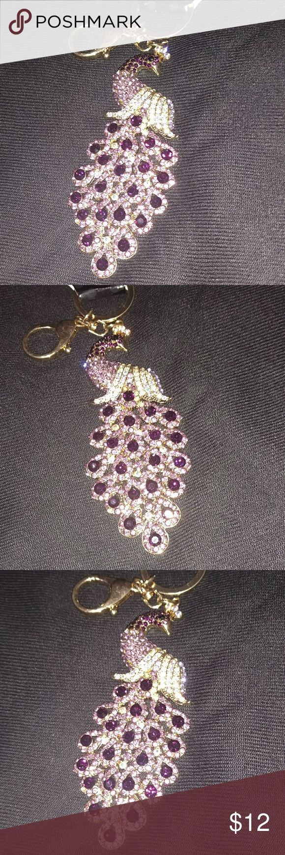 Gorgeous Peacock keychain. Amethyst and deep purple stones. Very large 6 inches! Made by Cinderella! Lab created stones. Jewelry