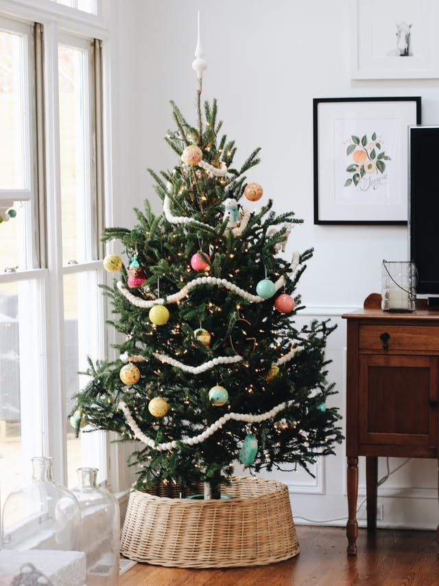 Christmas Tree Skirt Alternatives: Tree in a Basket | Say goodbye to the tree skirt and hello to this unexpected accessory.