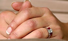 This is the ring that Crown Prince Frederick gave to his wife Mary Donaldson. It is in the colors of the Danish flag, red and white. The whole flag thing is a long standing tradition in Denmark. Mary's ring is an emerald cut diamond flanked by emerald cut rubies on either side.