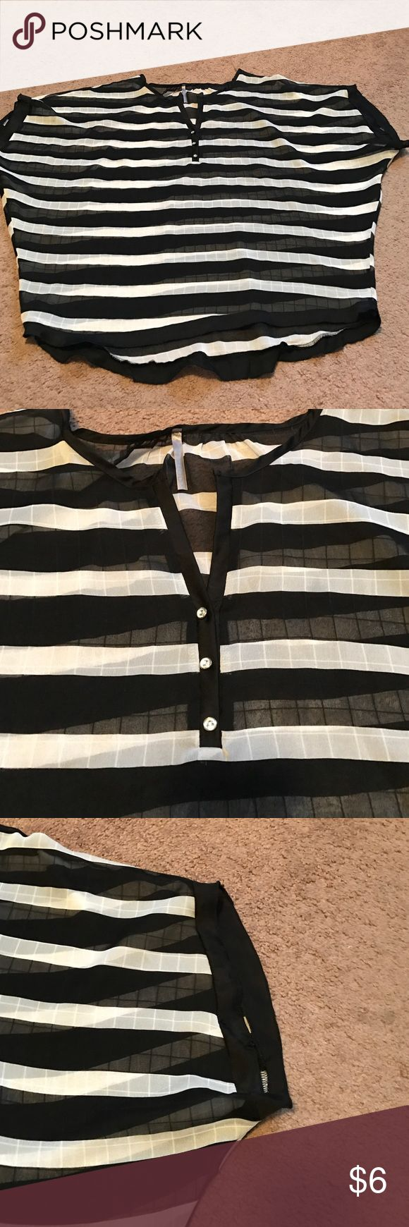Black and white striped see-through women's top Gently used black and white striped V-neck women's top open arms tapered to the waste trdo Tops Blouses