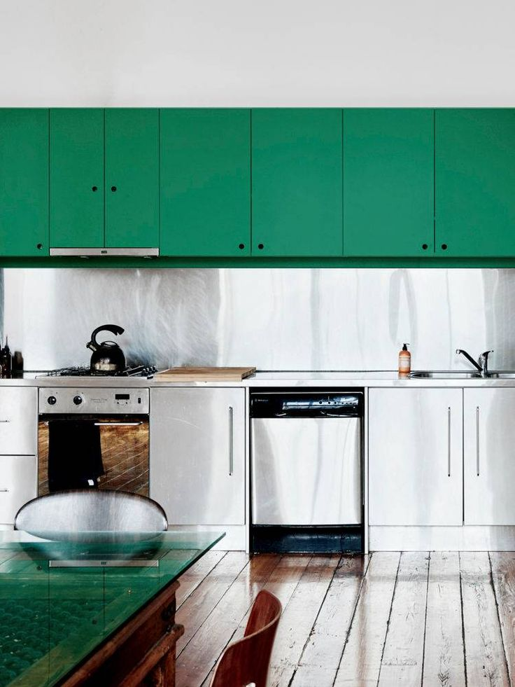 stainless steel backsplash, green cabinets.