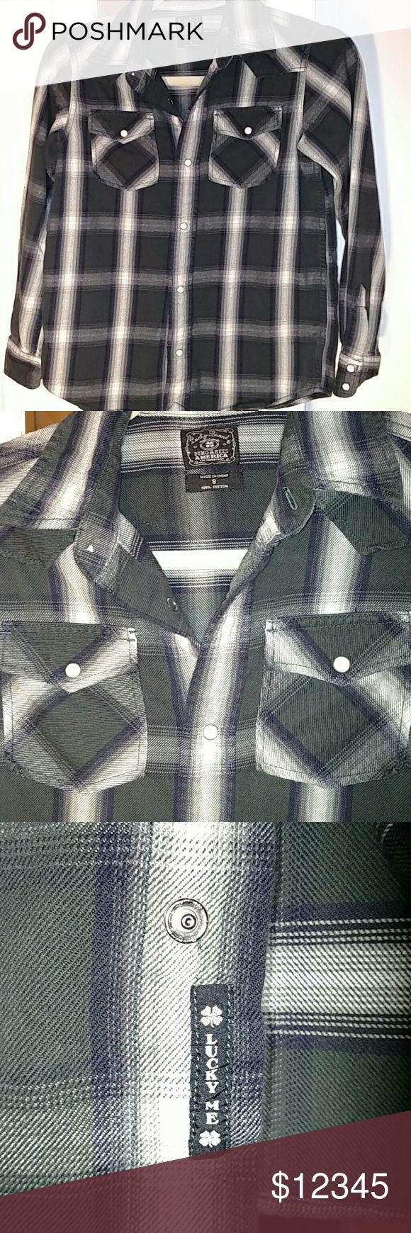 "BOYS SHIRT SIZE: 8 😍. ""Lucky Me"" Adorable! Lucky Brand Dungarees America "" Too Tough To Die"" Plaid flannel shirt; (Black, grey, cream plaid) w/snap buttons, ""lucky me"" label.....Soo cute!   😍 Offers Welcomed & Encouraged 😄  Reasonable Offers Accepted 🛍  Every ❤ placed in a bundle eligible for discounts!😘 Lucky Brand Shirts & Tops Button Down Shirts"